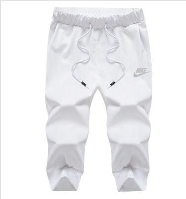 3d32784b0bfe7d24818c26cba7becd63 - Nike 經典 男款 束口 7分褲 白色 運動褲 休閒褲 短褲
