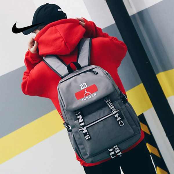 NIKE 流蘇款23號 Jordan 時尚後背包 大容量雙肩包 學生書包 旅行包 街頭潮流包 運動包 灰色